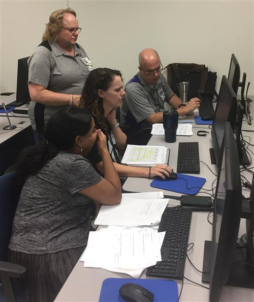 Computer Science teachers collaborating.