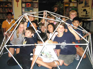 Elementary PACE students within a geodesic dome