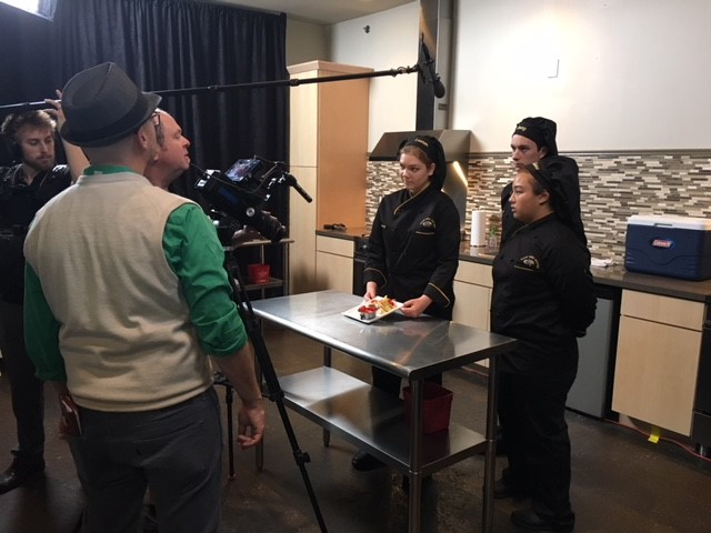 Plano East Culinary Team being filmed at live competition