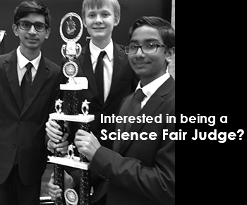 Interested in Being a Science Fair Judge (students holding large trophy)