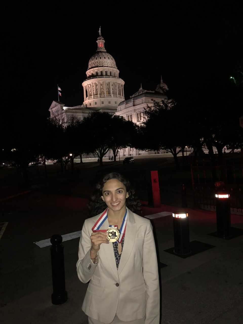 Mishan Kara, UIL 6A Congressional Debate State Champion with her medal