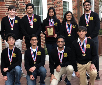Plano East Academic Decathalon team picture with plaque