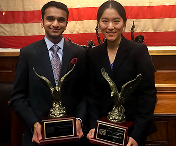 Plano West students Nikhil Ramaswamy and Jacqueline Wei with trophies