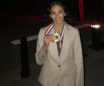 Mishan Kara, PWSH in Austin with her medal