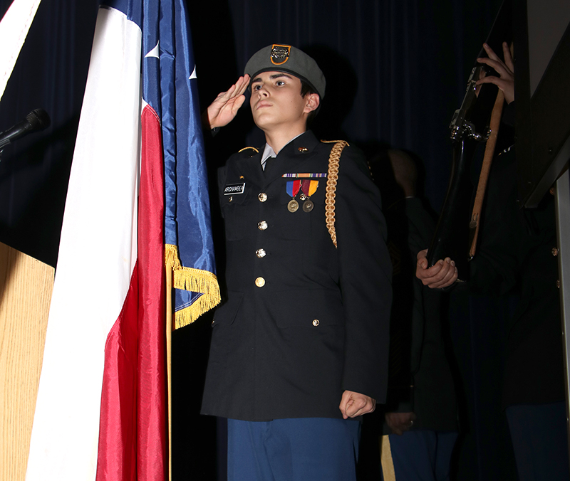 Williams HS Panther Battalion Cadet Staff Sergeant Wesley Archambeault salutes Texas flag