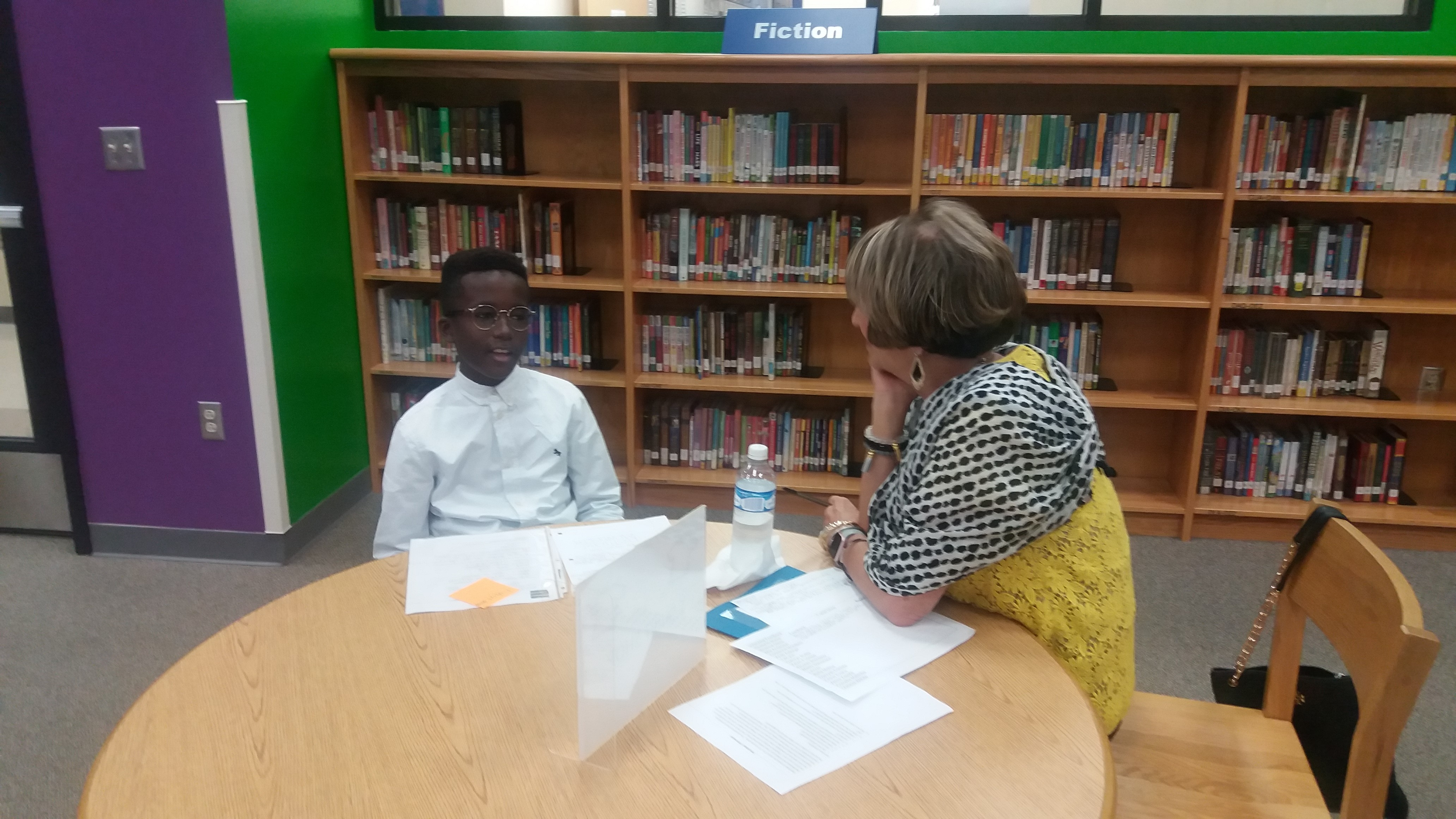 Assistant Superintendent for Campus Services interviews Huffman 5th grader