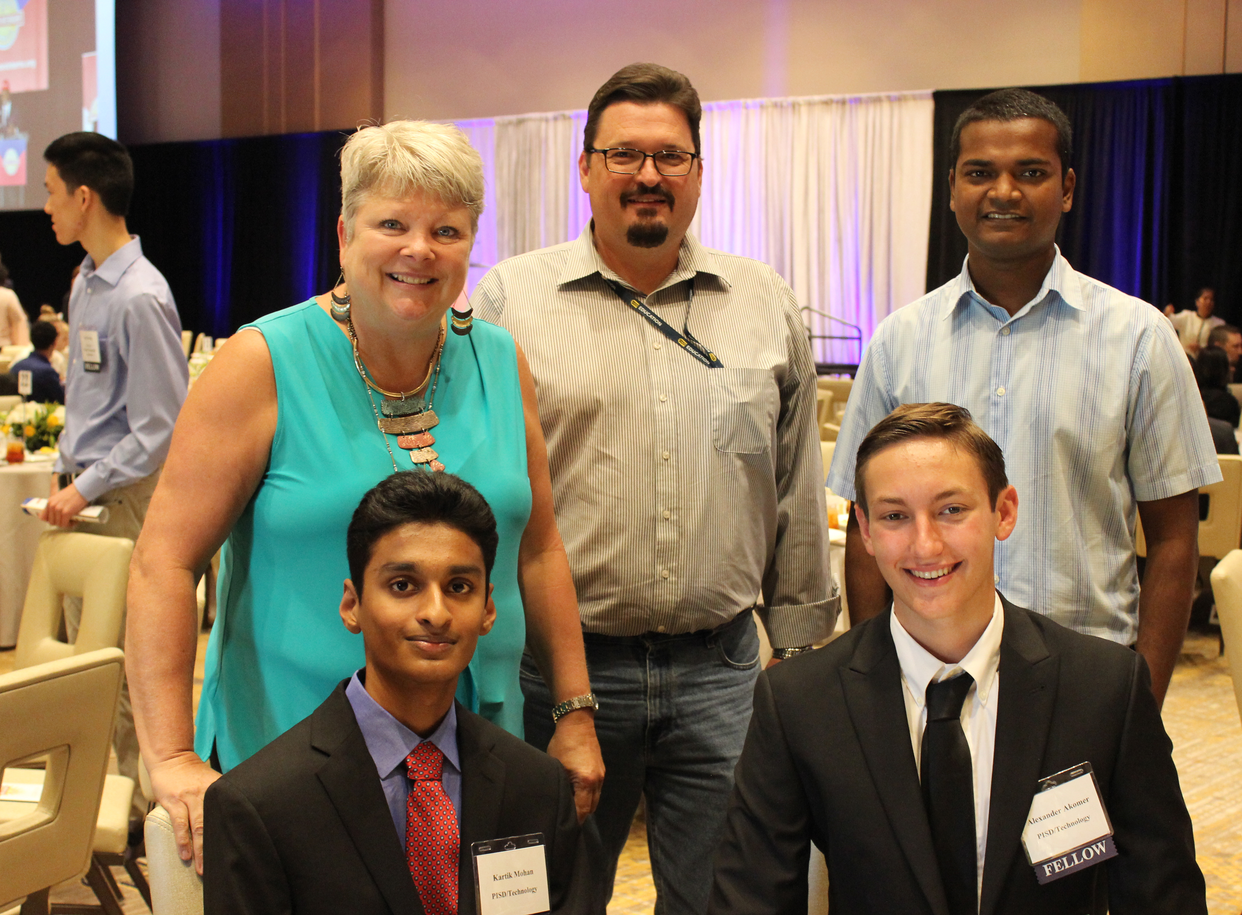 Technology Services summer interns Kartik Mohan and Alex Akomer with Technology staff at celebration luncheon