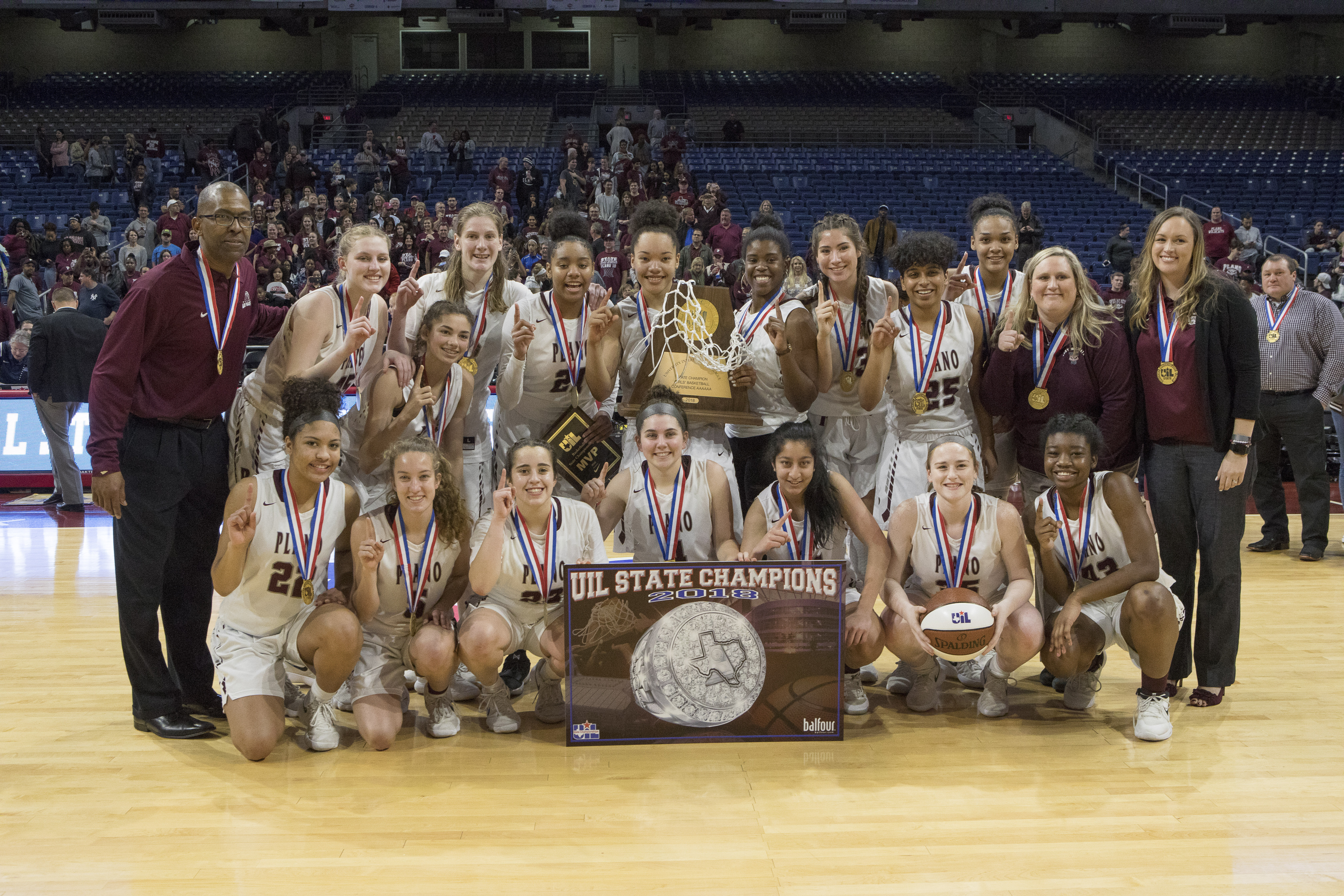 Lady Wildcats Basket Ball UIL State Champions team photo with trophy.