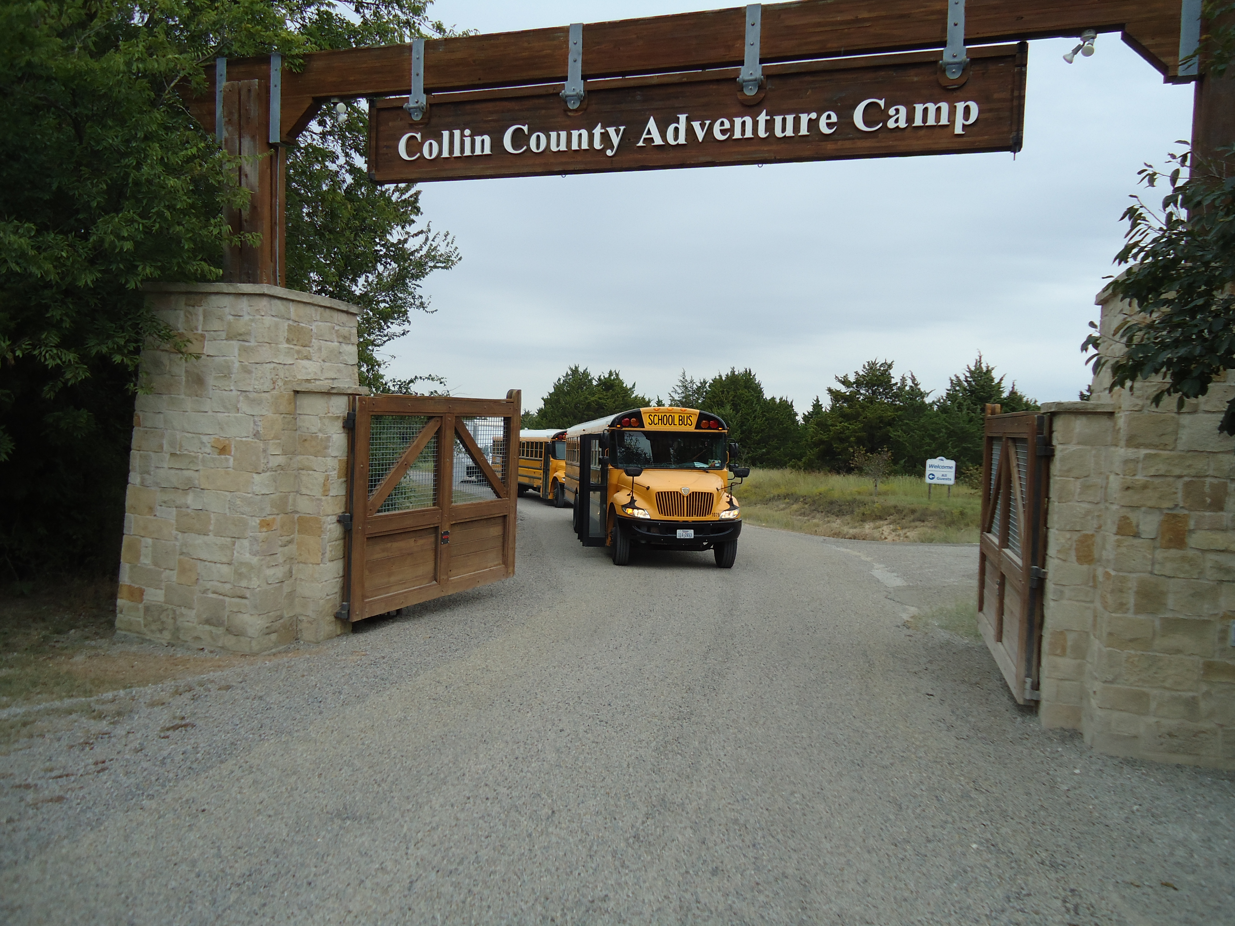 Collin County Adventure Camp open gate with arriving buses