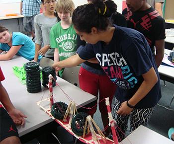 Camp students testing their bridge engineering projects