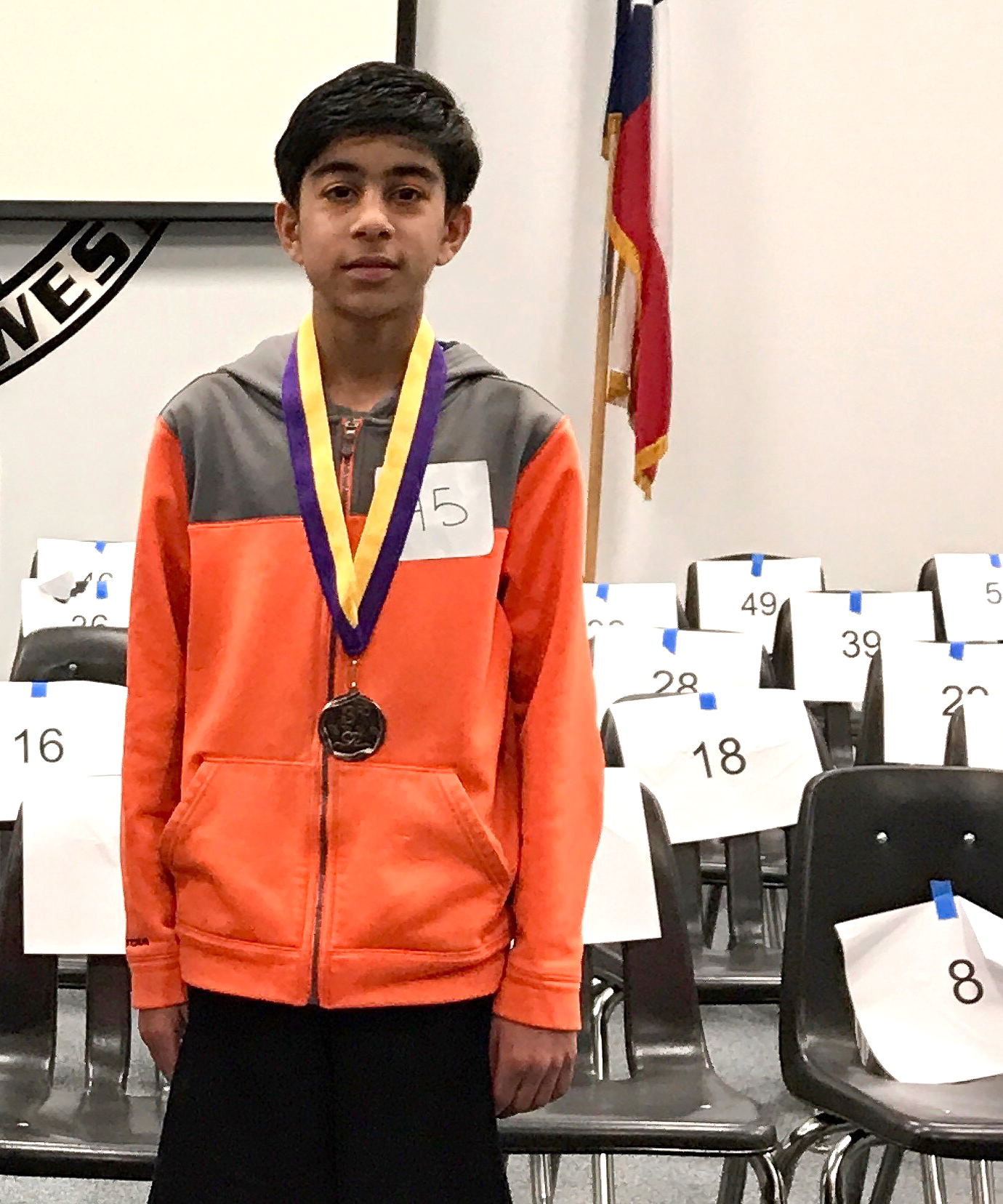Satvik Mahendra, Rice MS with his Collin County Spelling Bee medal