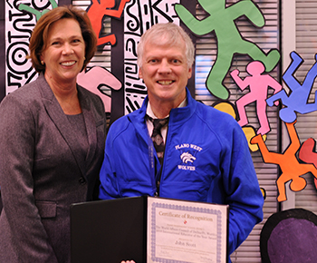 Plano West  Principal Kathy King and teacher John Scott