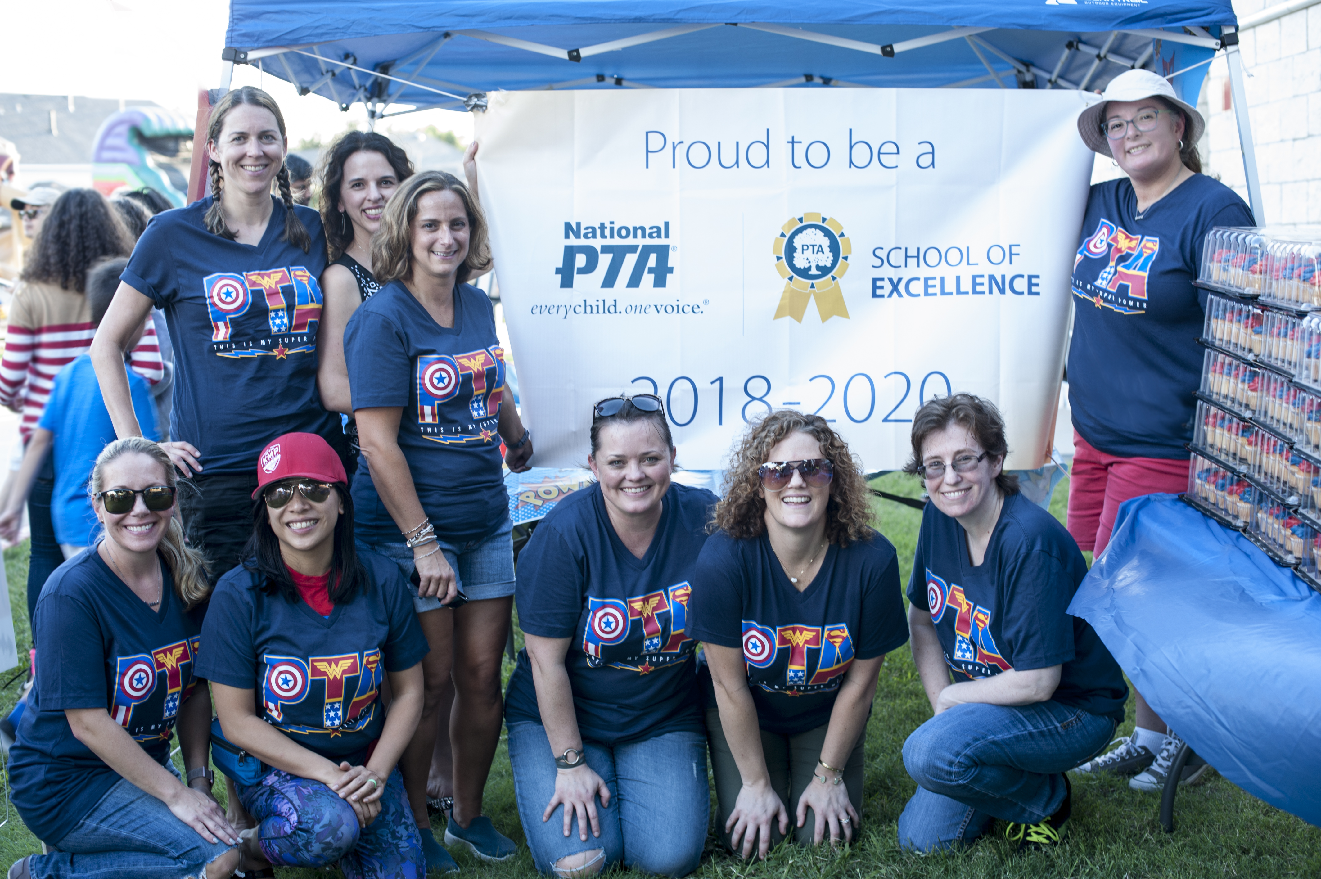 Haun PTA president and officers with sign Proud to be School of Excellence