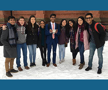 Jasper HS debate team standing in the snow