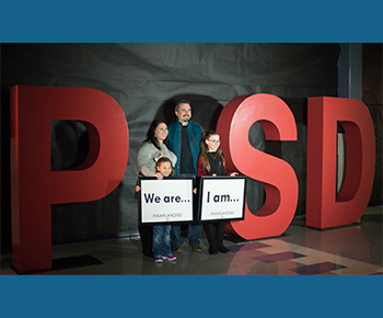 We Are Plano ISD - family holding sign
