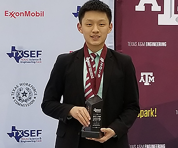 Kevin Meng PWSH 1st place winner with trophy