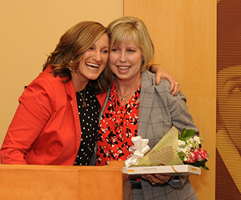 Chamber President Jamee Jolly and Plano ISD Board President Missy Bender at surprize announcement