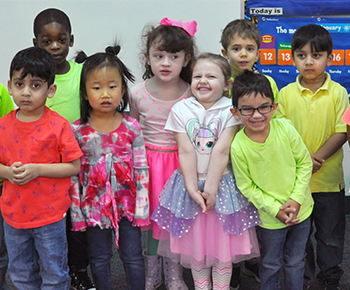 group of happy colorful prek students