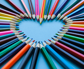 colorful pencils in heart shape