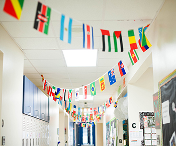 Huffman hallway with hanging world flags