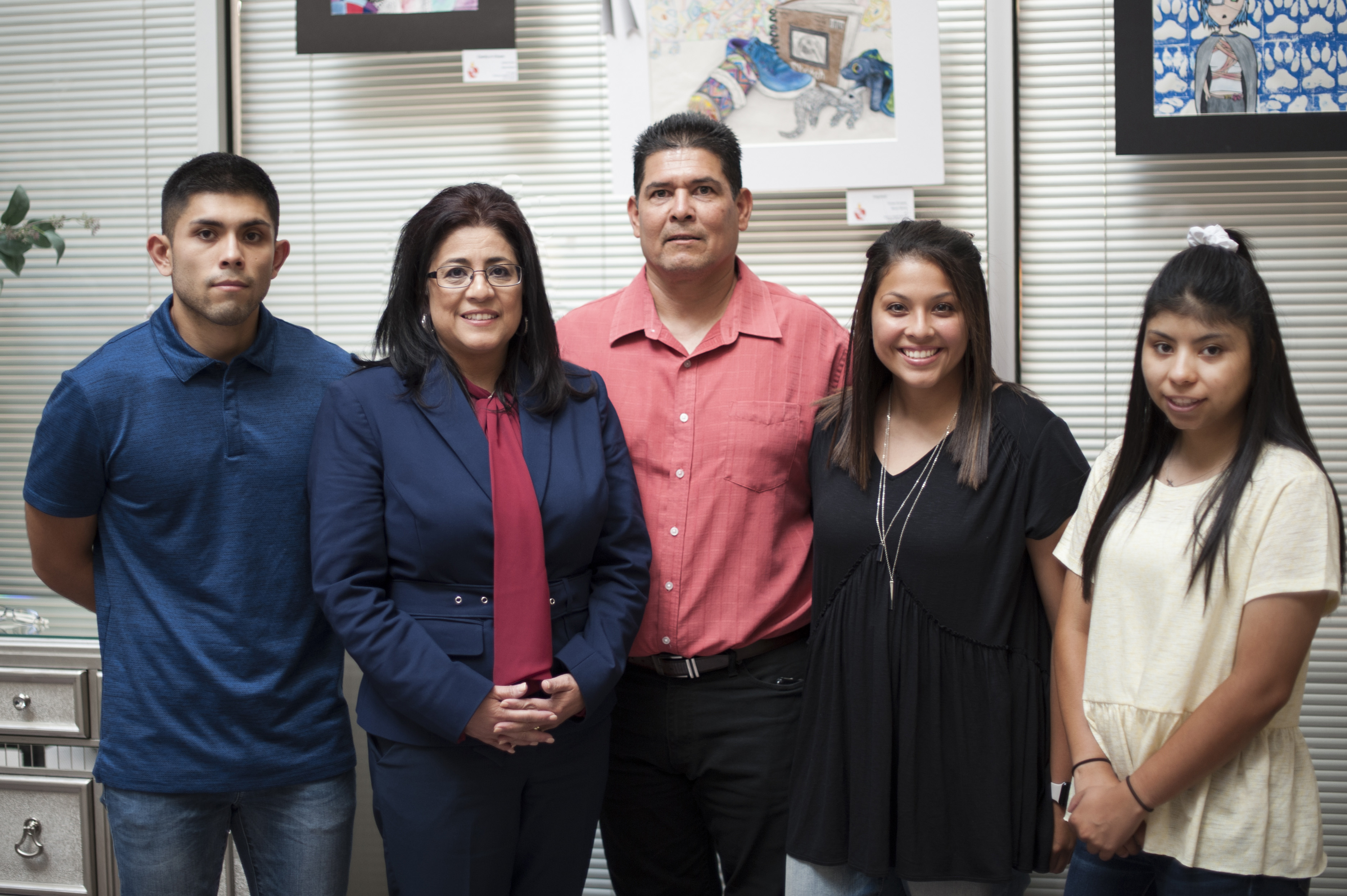 Gloria Martinez, husband, son and 2 daughters