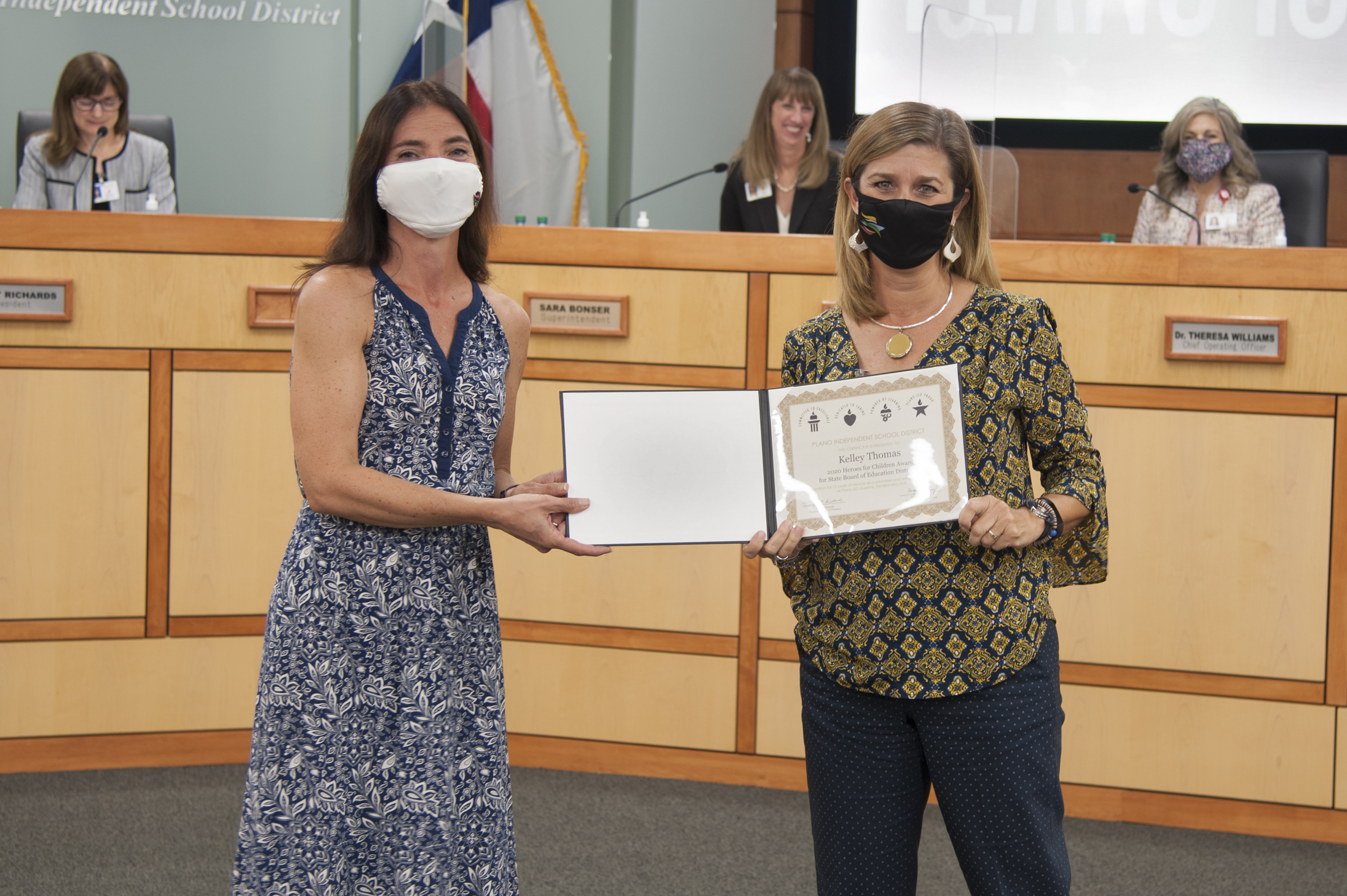 Kelley Thomas receives certificate of appreciation from Board VP Jeri Chambers