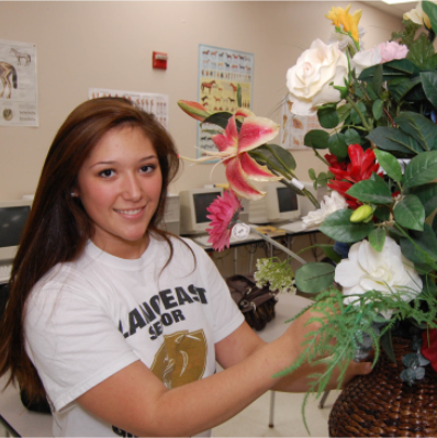 student with floral arrangement