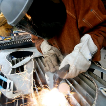Welder working on project