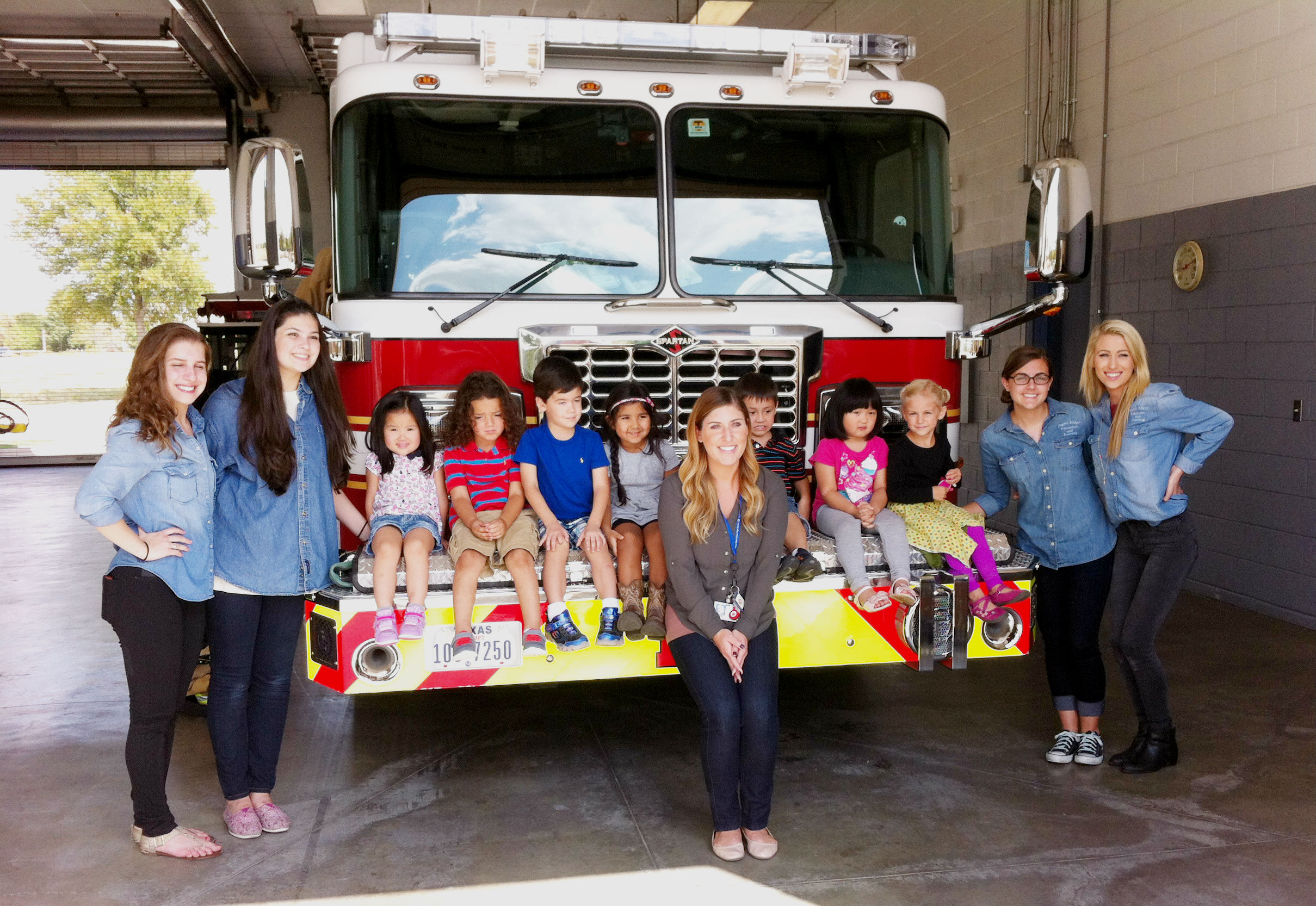 Preschool students and teachers visiting fire station