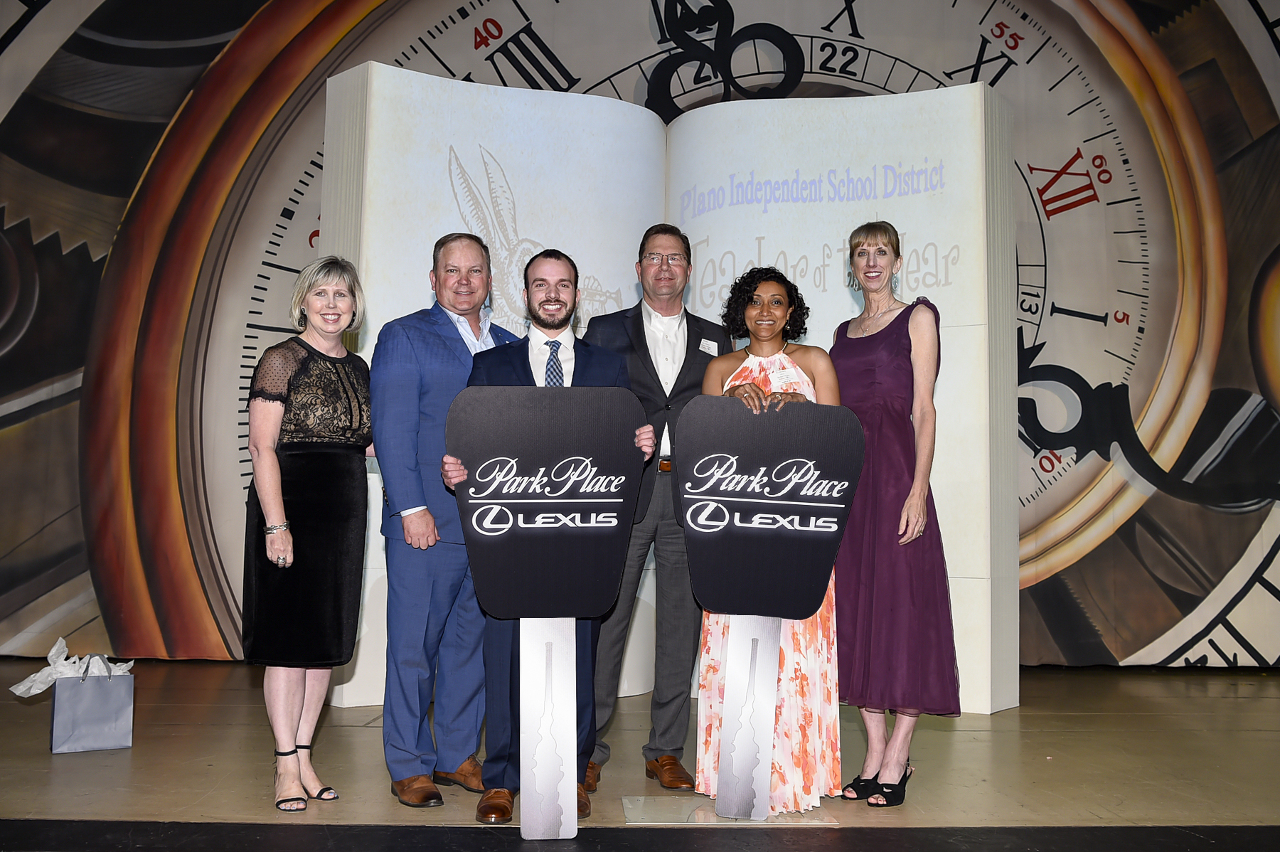 Winners with Board President and Superintendent and Lexus sponsors