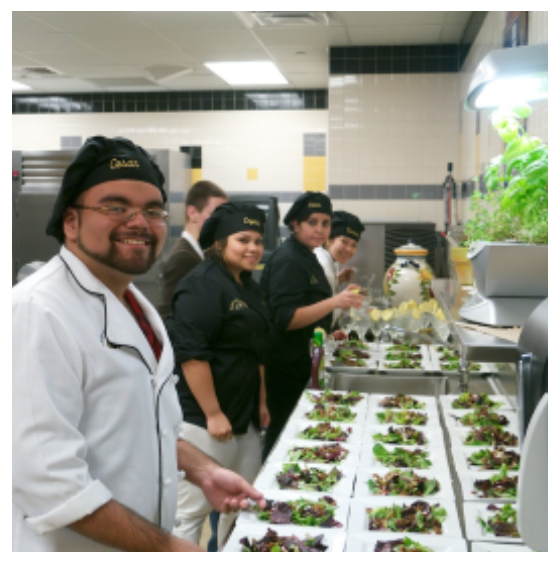 Group of students preparing salads for cafe
