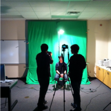 students working with green screen