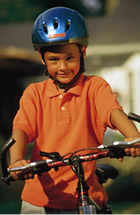 boy in orange shirt on a bike