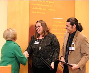 Laura and Matt Grundler with Board Secretary Nancy Humphrey
