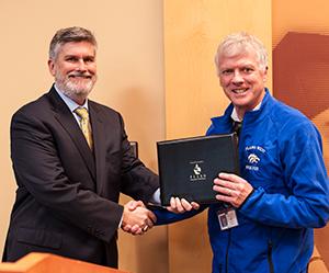Board VP David Stolle and International Educator of the Year John Scott PWSH