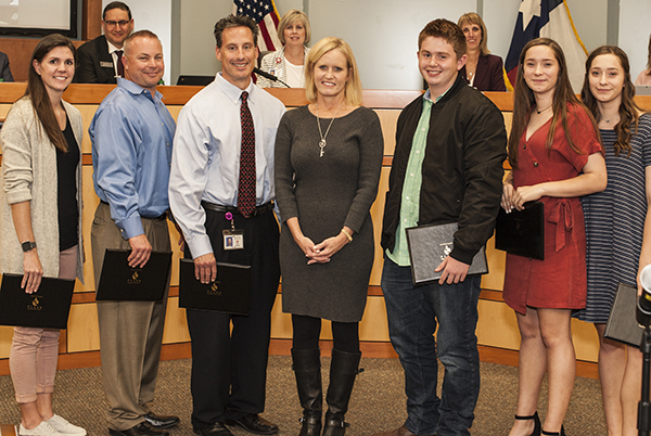 Team of Staff and students who saved school volunteer's life.