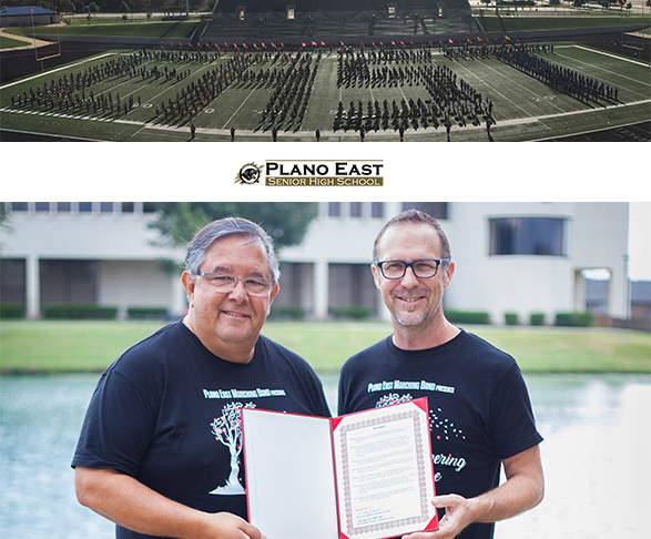 Band Director Evelio Villareal and John Brenan accept board resolution on behalf of the Plano East Band program