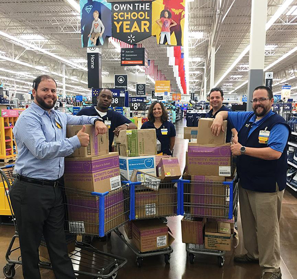 Walmart employees with carts filled with donations