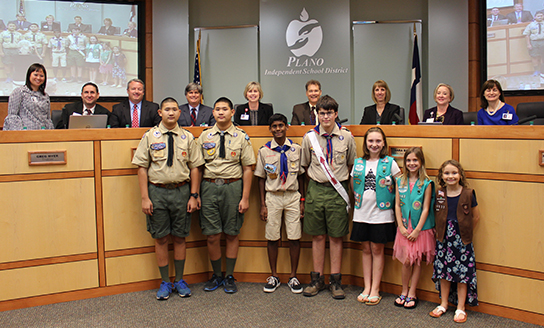 Student Greeters, 4 Boy Scouts and 3 Girl Scouts, are pictured with the Board of Trustees