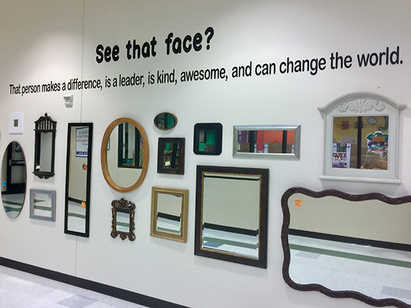 mirror displayed on wall with message - See that Face? That person makes a difference, is a leader, is kind, awesome and can change the world.