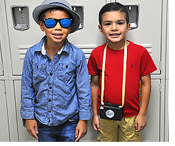 Boggess student travelers with sunglasses and camera