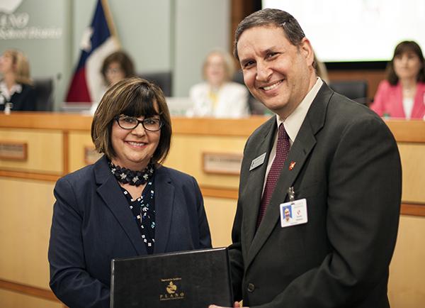 Barksdale teacher Celene Rosen receiving certificate from Board VP