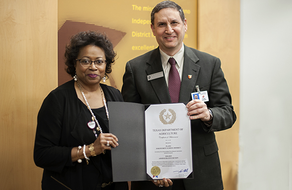 FANS Dir. Cynthia Lee receiving certificate from Board VP