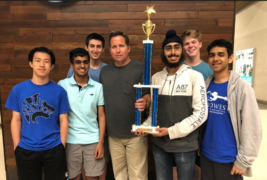 Plano West Whiz Quiz team with trophy