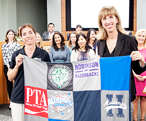 Council President and superintendent with PTA quilt
