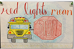 bus poster art: red lights mean STOP